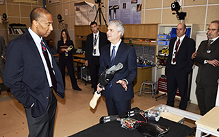 Dr. Glenn Klute discusses his development of a prosthetic limb that removes sweat with VA Deputy Chief of Staff Hughes Turner.